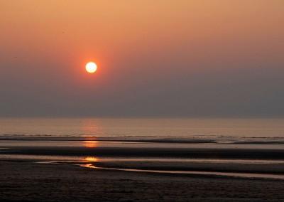 Soleil couchant sur la plage de Deauville